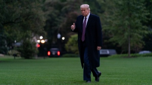U.S. President Donald Trump gives the thumbs-up as he walks from Marine One to the White House in Washington, Thursday, Oct. 1, 2020, as he returns from Bedminster, N.J. (AP Photo/Carolyn Kaster)