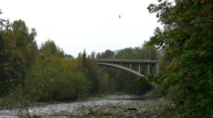 An RCMP helicopter circles above the Capilano River on Thursday, Oct. 1, 2020.