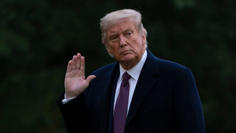 U.S. President Donald Trump waves as he walks from Marine One to the White House in Washington, Thursday, Oct. 1, 2020, as he returns from Bedminster, N.J. (AP Photo/Carolyn Kaster)