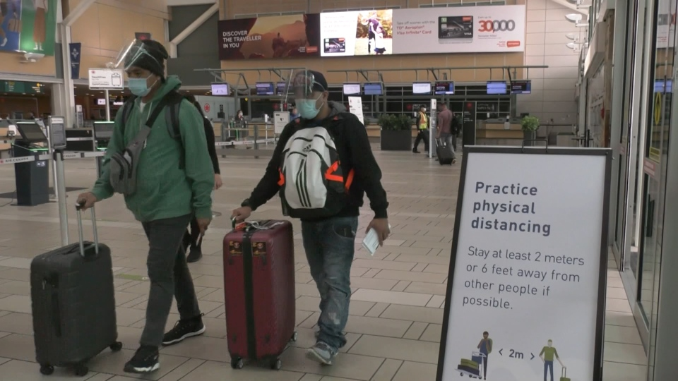 Travellers at Vancouver International Airport are seen on Oct. 1, 2020.