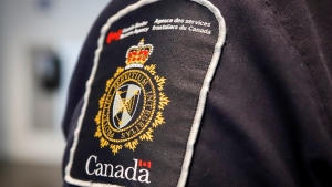 A Canada Border Services Agency (CBSA) patch is seen on an officer in Calgary, Thursday, Aug. 1, 2019. (Jeff McIntosh / THE CANADIAN PRESS)
