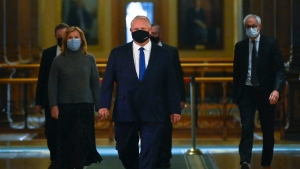 Ontario Premier Doug Ford, centre, walks to a press conference regarding new restrictions at Queen's Park during the COVID-19 pandemic in Toronto on Friday, October 2, 2020. THE CANADIAN PRESS/Nathan Denette
