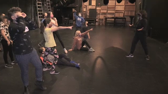 Students act on stage during STC's drama class.