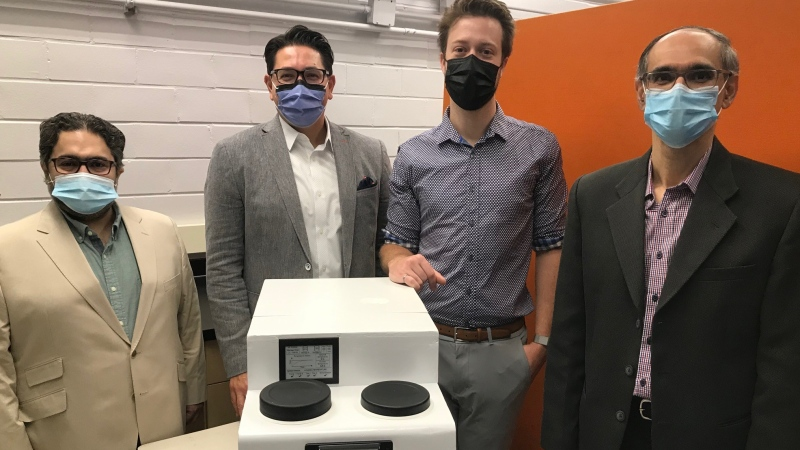 Western University's new portable temperature regulating device is seen with member of its research and development team. From right is Tamer Mohamed, Dr. Alp Sener, Steven Jevnikar & Kamran Siddiqui. (Sean Irvine CTV News)