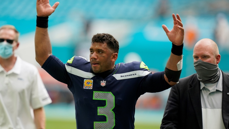 Seattle Seahawks quarterback Russell Wilson (3) raises his hands as fans cheer at the end of an NFL football game, Sunday, Oct. 4, 2020 in Miami Gardens, Fla. (AP / Wilfredo Lee)