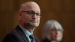 Justice Minister David Lametti and Minister of Health Patty Hajdu listens to a speaker during a news conference Monday October 5, 2020 in Ottawa. THE CANADIAN PRESS/Adrian Wyld