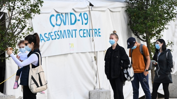 People wait in line at a COVID assessment centre at Women's College Hospital during the COVID-19 pandemic in Toronto on Wednesday, September 23, 2020. THE CANADIAN PRESS/Nathan Denette