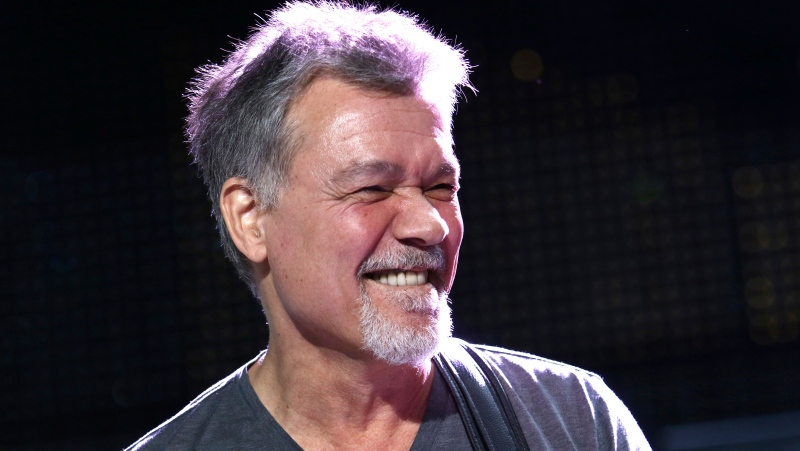 Eddie Van Halen of Van Halen performs on Aug. 13, 2015, in Wantagh, N.Y. Van Halen, who had battled cancer, died Tuesday, Oct. 6, 2020. He was 65. (Photo by Greg Allen/Invision/AP, File)