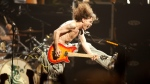 Eddie Van Halen plays the final chord of 'Jump' during a concert at the Continental Airlines Arena in East Rutherford, N,.J., on June 22, 2004. (John Munson / NJ Advance Media via AP)