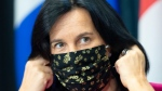 Montreal Mayor Valérie Plante removes her face mask as she arrives at a news conference, Friday, September 18, 2020 in Montreal.THE CANADIAN PRESS/Ryan Remiorz