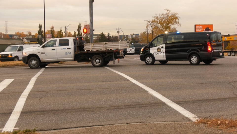 A CPS vehicle and a truck in the intersection of Blackfoot Trail and 46 Ave S.E. after two pedestrians were struck Wednesday morning