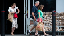 People leave a grocery store using plastic bags in Mississauga, Ont., on Thursday, August 15, 2019. THE CANADIAN PRESS/Nathan Denette