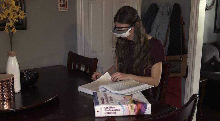 London student Emma Van Dyk using eSight glasses