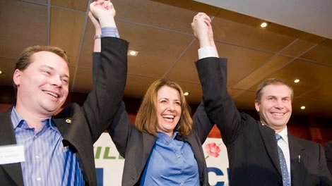 Mark Dyrholm, (left) Danielle Smith (centre) and Paul Hinman (right) celebrate Smith's win of the leadership of the Wildrose Alliance Party in Edmonton, Alberta on Saturday, Oct. 17, 2009 (Ian Jackson / THE CANADIAN PRESS)