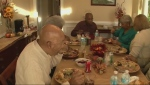 Family at table for Thanksgiving dinner (file)