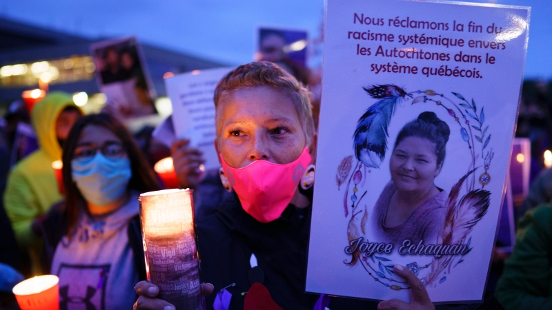 A woman attends a vigil in front of the hospital where Joyce Echaquan died in Joliette, Que. on Tuesday, September 29, 2020. A nurse has been fired after Echaquan, an Indigenous woman, who was dying Monday night in hospital was subjected to degrading remarks. THE CANADIAN PRESS/Paul Chiasson