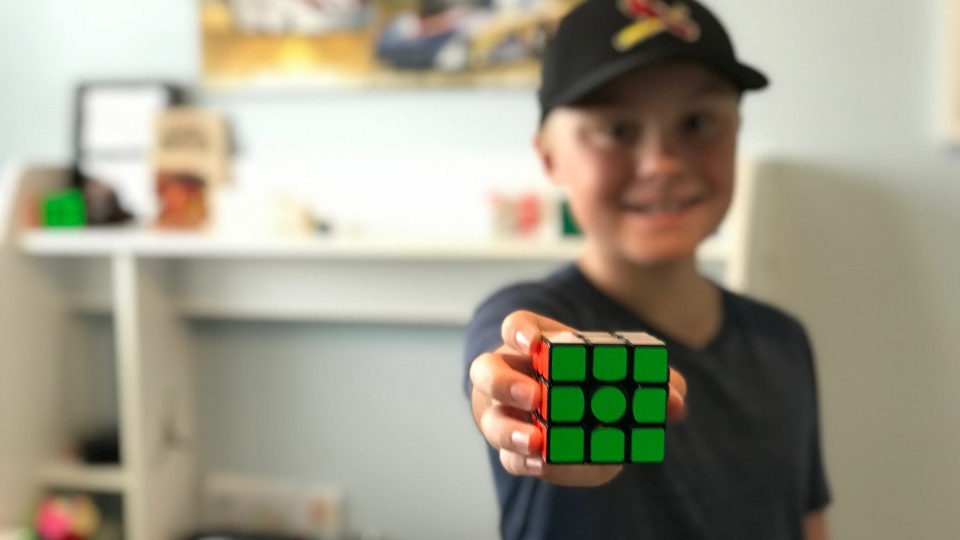 Wyatt Atchison, 12-year-old speedcuber holding a Rubik's cube on October 7, 2020.