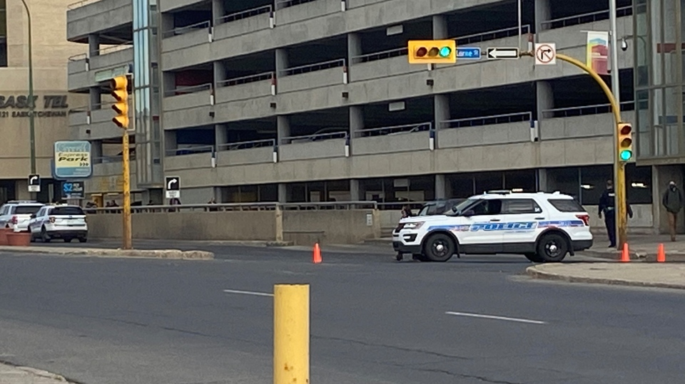 Police cruisers outside the Cornwall Centre parkade on Saskatchewan Drive. Officers investigated a potential bomb threat on Wednesday. (CTV News)