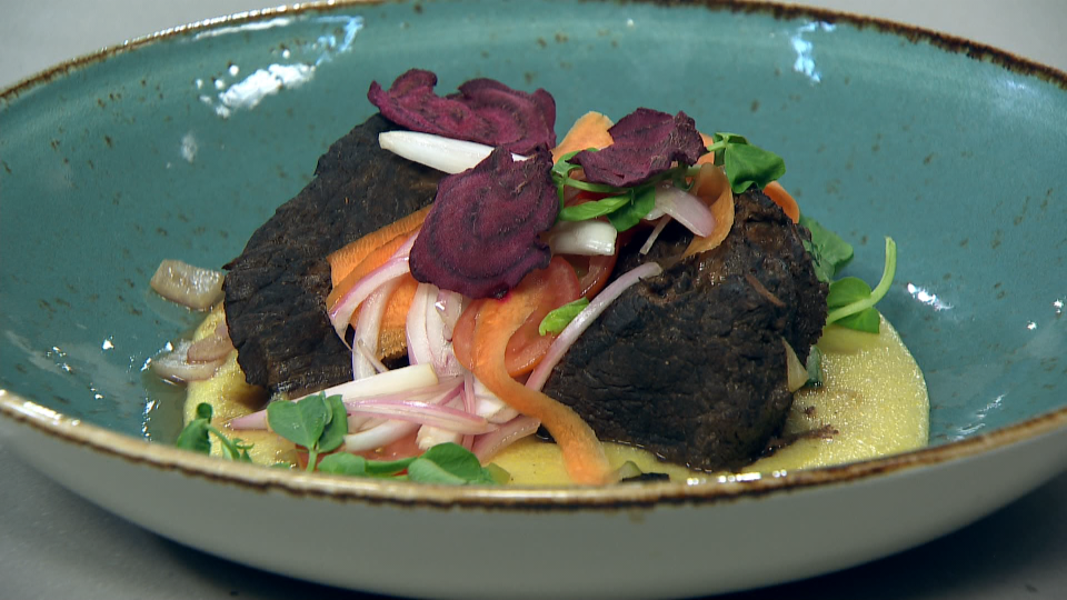 Braised Alberta venison, with smoked cheddar polenta and quick pickled vegetables from Executive Chef Jamie Hussey from The Pines Restaurant at Pyramid Lake Resort.