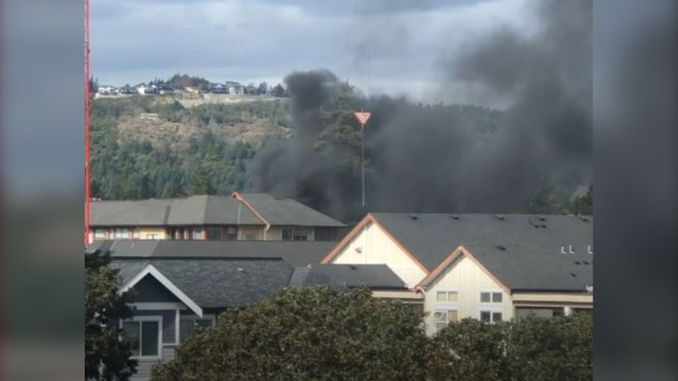 Video posted to social media Thursday afternoon shows thick black smoke in the area. (Karen Green)