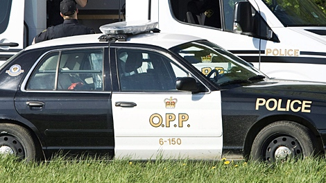 An OPP forensic unit gathers evidence at a scene of interest as police investigate the disappearance of eight year-old Victoria 'Tori' Stafford near Fergus, Ont., on Thursday, May 21, 2009. (Nathan Denette / THE CANADIAN PRESS)