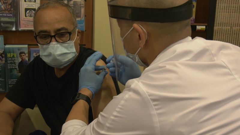 Victor Chu administers a flu shot at his downtown Vancouver Pharmasave on Thursday, Oct. 8, 2020. (CTV)