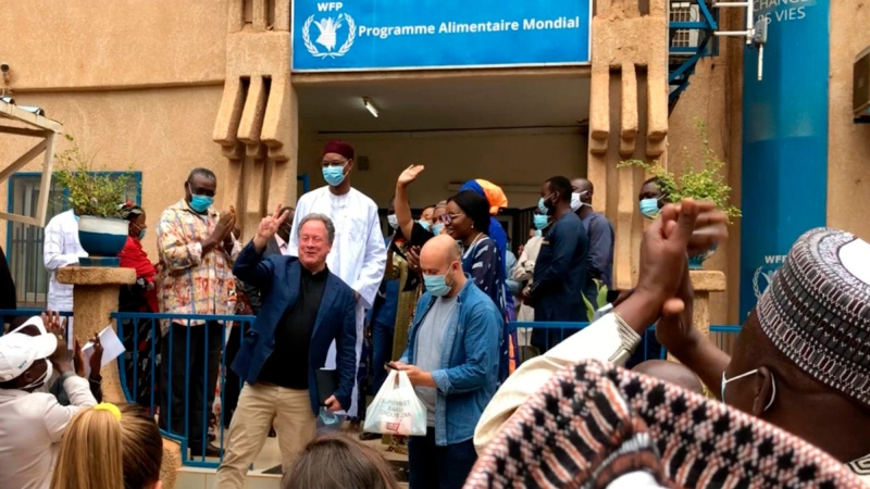 David Beasley, Executive director of the World Food Program (WFP), centre, celebrates with members of WFP staff in Niamey, Niger, on Oct. 9, 2020, after being awarded the 2020 Nobel Peace prize. (WFP via AP)