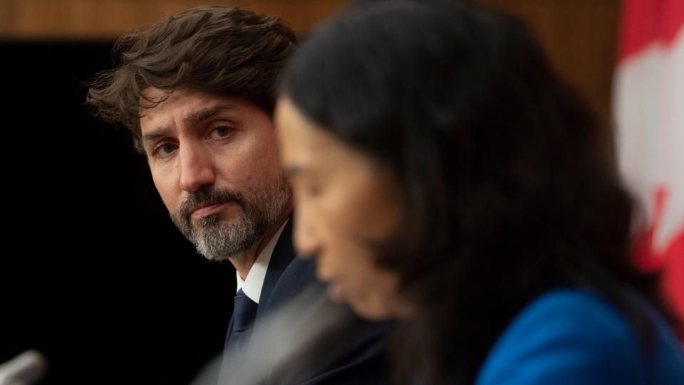 Canadian Prime Minister Justin Trudeau looks on as Chief Public Health Officer Theresa Tam delivers her opening remarks during a news conference Monday October 5, 2020 in Ottawa. THE CANADIAN PRESS/Adrian Wyld