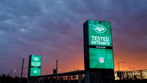 Security stands indicate entrances for tested and non-tested personnel entering MetLife Stadium before an NFL football game between the New York Jets and the Denver Broncos during the coronavirus pandemic, Oct. 1, 2020, in East Rutherford, N.J. (AP Photo/Frank Franklin II)