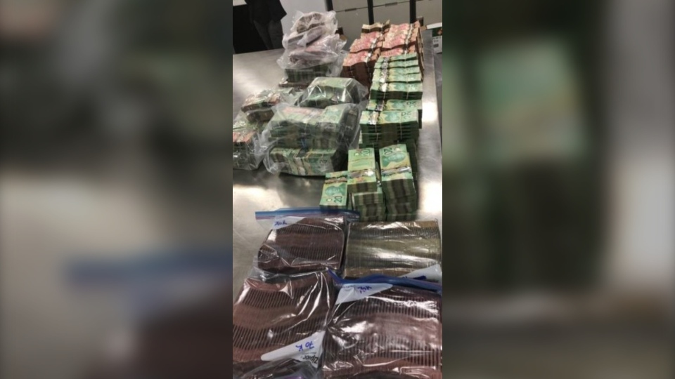 Drugs and cash seized by Calgary police during the search of three residences and three vehicles on Oct. 5 (supplied)