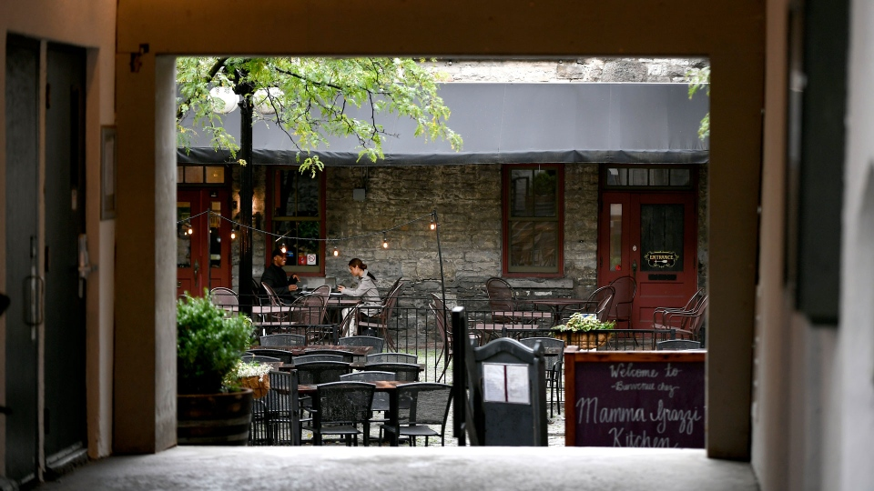 People dine under the shelter of a canopy in a courtyard restaurant in the Byward Market in Ottawa, on Sunday, Sept. 13, 2020, in the midst of the COVID-19 pandemic. THE CANADIAN PRESS/Justin Tang