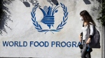 A woman walks past a sign at the entrance of the United Nations World Food Program (WFP), in Rome, Friday, Oct. 9, 2020. The WFP has won the 2020 Nobel Peace Prize for its efforts to combat hunger and food insecurity around the globe. The announcement was made Friday in Oslo by Berit Reiss-Andersen, the chair of the Nobel Committee. THE CANADIAN PRESS/AP/Gregorio Borgia