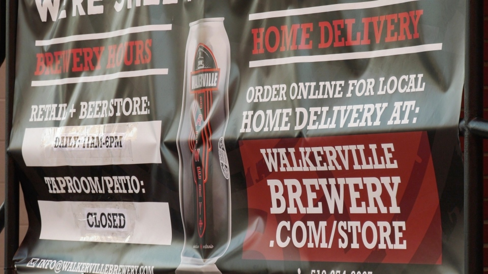 The Walkerville Brewery has seen an increase in sales thanks to relaxed regulations that allow direct-to-customer delivery. A banner at the brewery advertises its delivery option seen on Friday, October 9, 2020. (Ricardo Veneza/CTV Windsor)