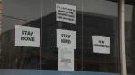 Signs in the window of an Ottawa business that is closed due to COVID-19. (CTV News Ottawa)