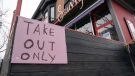 "A restaurant in Toronto displays a ""Take Out Only"" sign on March 18, 2020. THE CANADIAN PRESS/Frank Gunn"