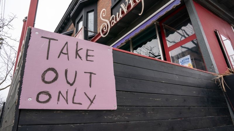 A restaurant in Toronto displays a 'Take Out Only' sign on March 18, 2020.  (Frank Gunn / THE CANADIAN PRESS)
