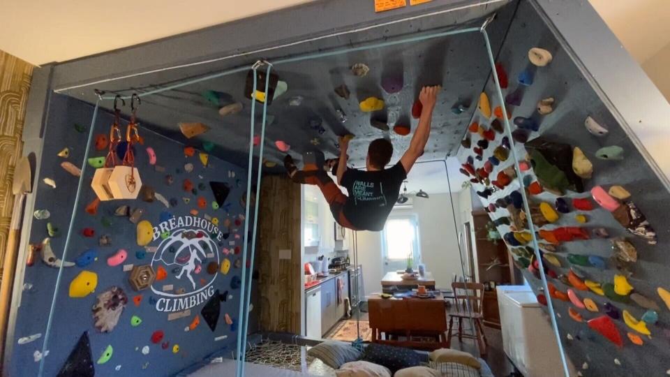 Students indoor wall climbing