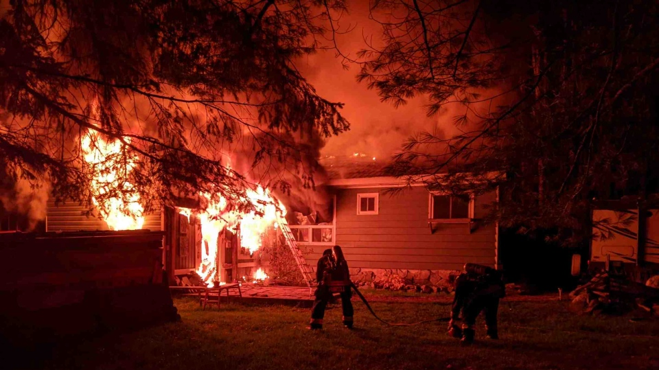 Firefighters battle a house fire in Port Sydney, Ont. on Sunday October 11, 2020 (Huntsville/Lake of Bays Fire Department)