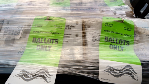 Pallets of voting ballots are ready for mailing to the United States Postal Service as they are displayed to the media at the Orange County Registrar of Voters, in Santa Ana, Calif., on Oct. 5, 2020. (Damian Dovarganes / AP)