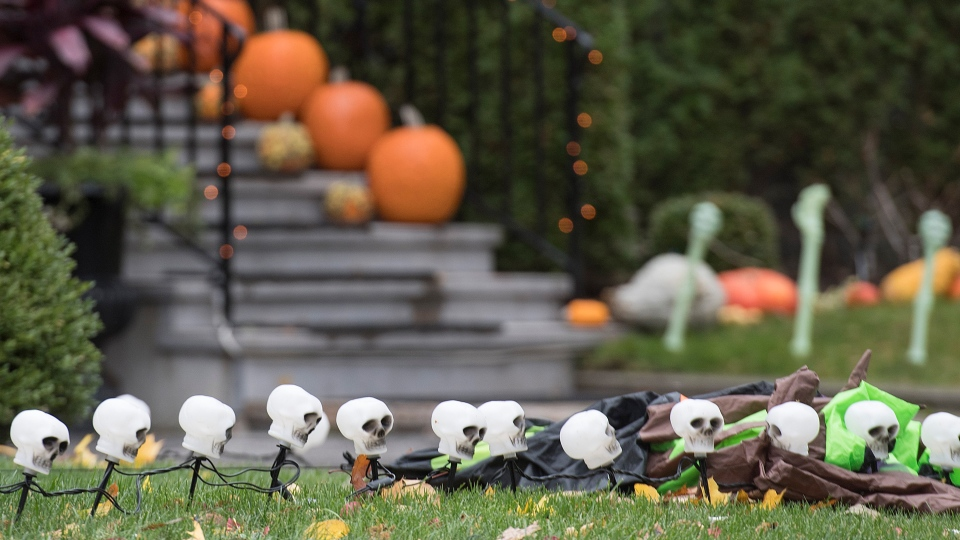 Halloween decorations and pumpkins are shown at a house in Montreal, Friday, November 1, 2019. THE CANADIAN PRESS/Graham Hughes
