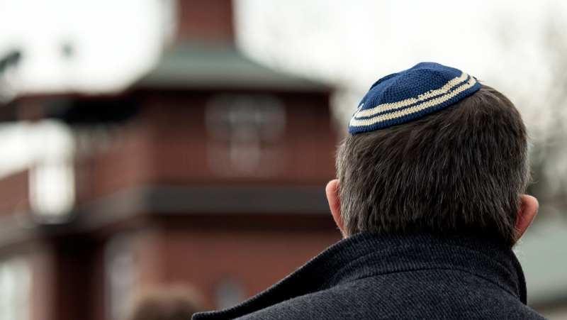 A man with a Jewish yarmulke takes part at a wreath ceremony on occasion of the international Holocaust remembrance day in the former the Nazi concentration camp Buchenwald near Weimar, Germany, Jan. 27, 2020. (AP Photo/Jens Meyer)