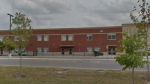 Holy Name Catholic Elementary School is shown in a Google Streetview image.