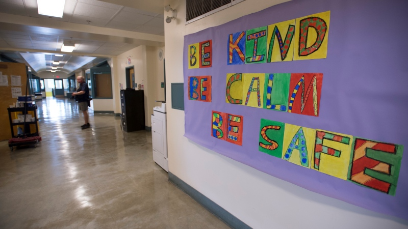 Dr. Bonnie Henry's words are pictured on the bulletin board in the hallway of B.C. school on Wednesday, Sept. 2, 2020. (Jonathan Hayward / THE CANADIAN PRESS)