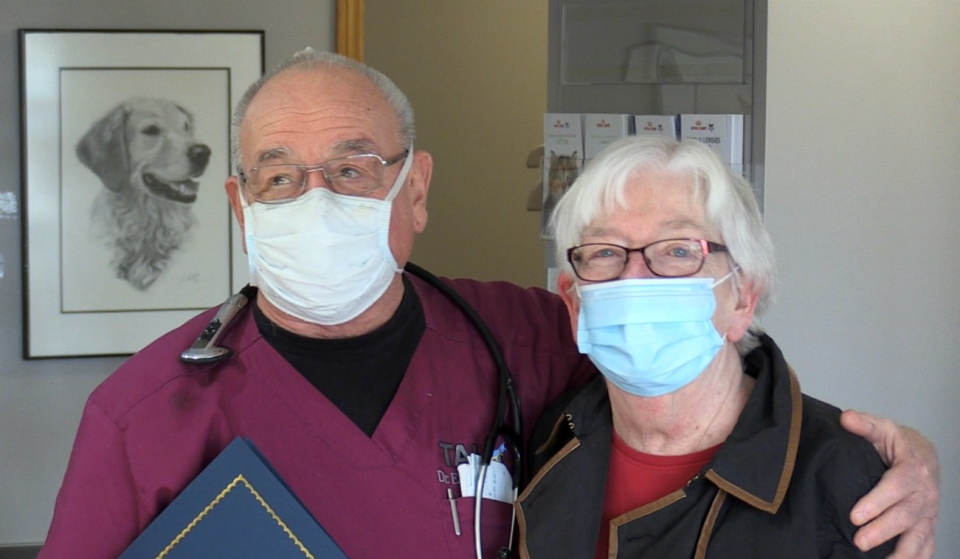 Timmins Animal Hospital owner and veterinarian Dr. Ed Butterworth and practice manager Edith Butterworth celebrate 50 years in business with the Timmins Chamber, Mayor George Pirie and a roomful of clients. (Sergio Arangio/CTV News)