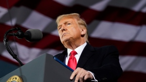 U.S. President Donald Trump speaks at a campaign rally at Des Moines International Airport, Wednesday, Oct. 14, 2020, in Des Moines, Iowa. (AP Photo/Alex Brandon)