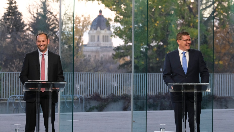 Saskatchewan Party Leader Scott Moe and Saskatchewan NDP Leader Ryan Meili laugh before the start of the Leaders' Debate at the Provincial Archives in Regina on Wednesday Oct. 14, 2020. THE CANADIAN PRESS/Michael Bell