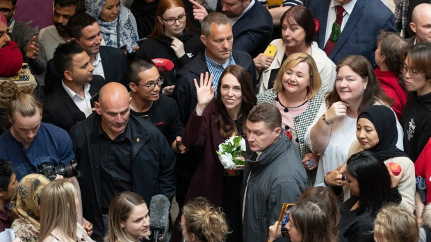 New Zealand Prime Minister Jacinda Ardern, center, waves as she arrives at a shopping mall in Christchurch, New Zealand, Wednesday, Oct. 14, 2020. AP Photo/Mark Baker)