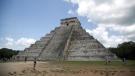 In this Aug. 3, 2018 file photo, tourists walk at the Mayan ruins of Chichen Itza in Mexico's Yucatan Peninsula. Experts in Mexico said Wednesday, Oct. 14, 2020, that they have detected more than 2,000 pre-Hispanic ruins or clusters of artefacts along the proposed route of the president's controversial Maya Train project on the Yucatan peninsula. (AP Photo/Eduardo Verdugo)
