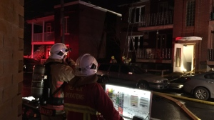 Quebec City firefighters put out a blaze that left a dozen people out of their homes Oct. 15, 2020. SOURCE SPCIQ