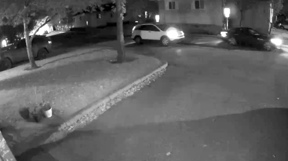 Surveillance footage of a white 2007 to 2009 Honda CRV believed to be involved in the shooting of Matthew Maniago. Police have not yet recovered this vehicle and are looking for the public's help to locate it. (Calgary police handout)